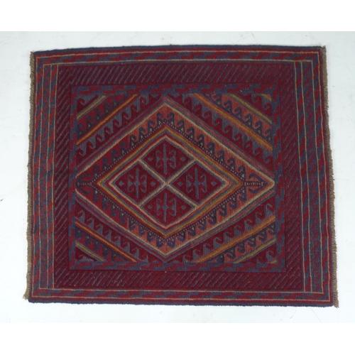 289 - A Gazak rug with large diamond medallion, 127 by 113cm....