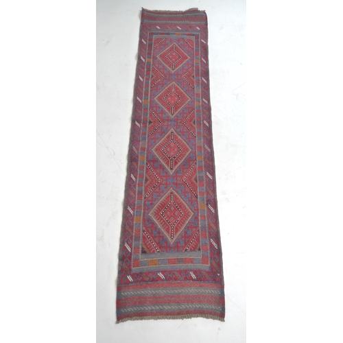291 - A Meshwari runner, with red and blue geometric ground, four diamond medallions, five stripe ends, 25...