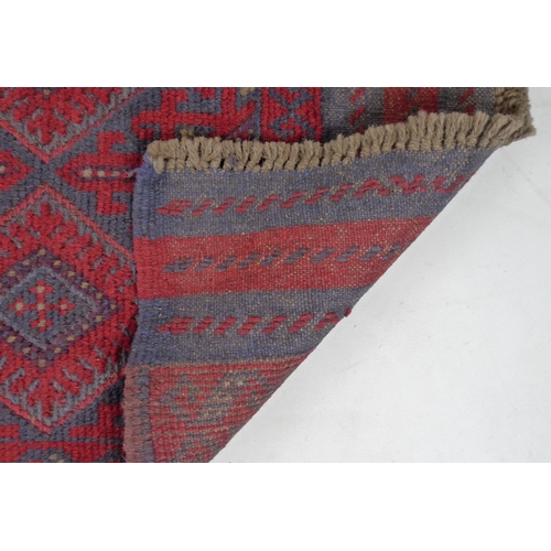 310 - A Meshwari runner, with red and blue geometric ground, five rows of two diamond medallions, three st...