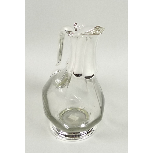 194 - A modern wine decanter, in the form of a duck, with clear glass body and silver plated mounts, 80cl ...