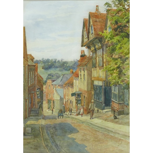 241 - Henry Sheppard Dale (1852-1921): a West country hillside town scene with Tudor buildings, with the D...