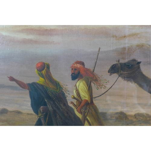 265 - Howard M Hunt (British, 19th century): a nomadic tribe journeying through the desert, with a woman a...