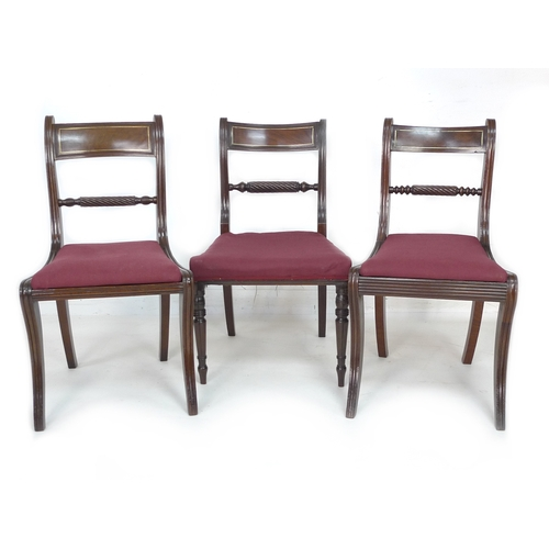 297 - A harlequin set of eight Regency bar back dining chairs, with brass inlaid top rails, spiral carved ...