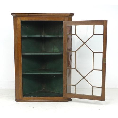 295 - A George III oak corner cupboard, with single astragal glazed door, 75.2 by 41 by 107cm high....