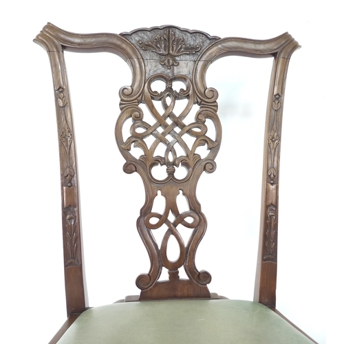 324 - A set of Edwardian Chippendale style eight dining chairs including two carvers, with decorative top ...