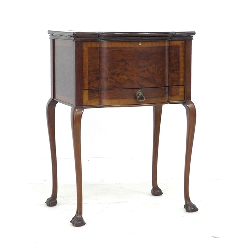303 - A 20th century mahogany sewing table, its fitted interior with dressing table items, the exterior wi...