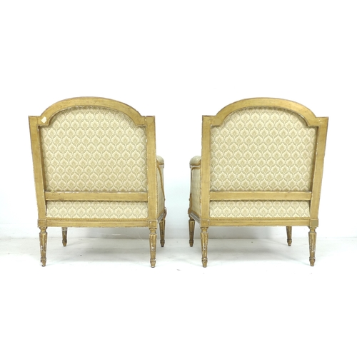 334 - A pair of French 19th century giltwood armchairs, with carved gilt frames, upholstered in cream foli...