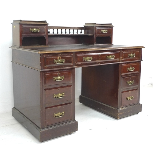 292 - An Edwardian mahogany desk, fitted gallery, inset surface, twin pedestals with a series of drawers, ...