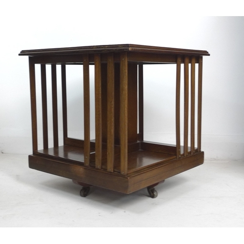 277 - An Edwardian mahogany revolving table top bookcase, with later base and castors, 46.5 by 46.6 by 46....