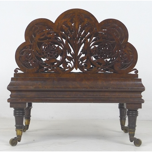 278 - An Edwardian burr walnut Canterbury, with pierced carved ends, raised upon turned legs and brass cas...