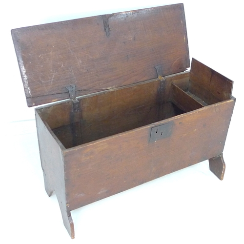 315 - An 18th century stained pine blanket chest, of plain form with saw cut feet, lift lid and candle box...