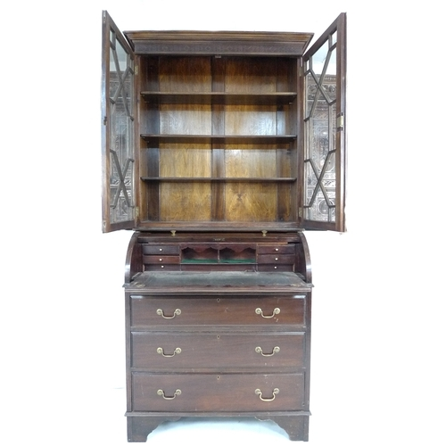 325 - A Georgian style mahogany cylinder front bureau bookcase, mid 20th century, twin astragal glazed doo...