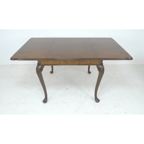 276 - A good quality burr walnut veneered extending dining table, circa 1940, in Queen Anne style, with mo...
