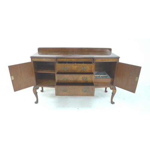 275 - A good quality walnut veneered sideboard, circa 1950, by Hamptons, Pall Mall East, London, raised on...