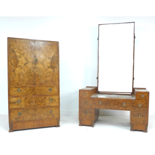 282 - An Art Deco walnut veneered part bedroom suite, comprising a dressing table with rectangular mirror ...