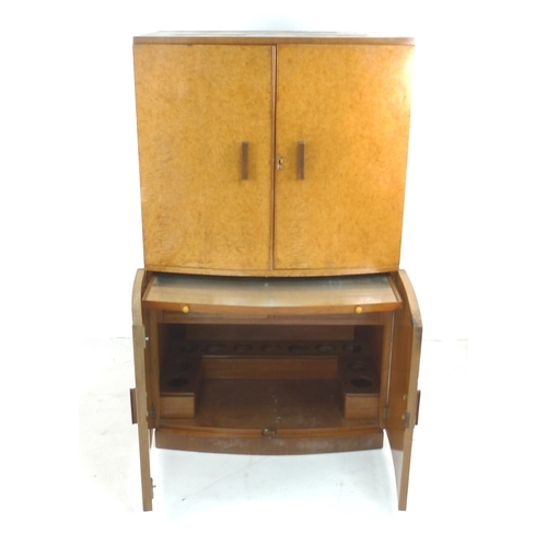 281 - An Art Deco birds eye maple veneered cocktail cabinet, bow fronted, with twin doors opening to revea...