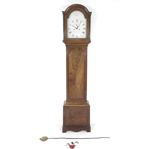 323 - An early 19th century mahogany long case clock, plain white arched dial signed Thos Inskip, Shefford...