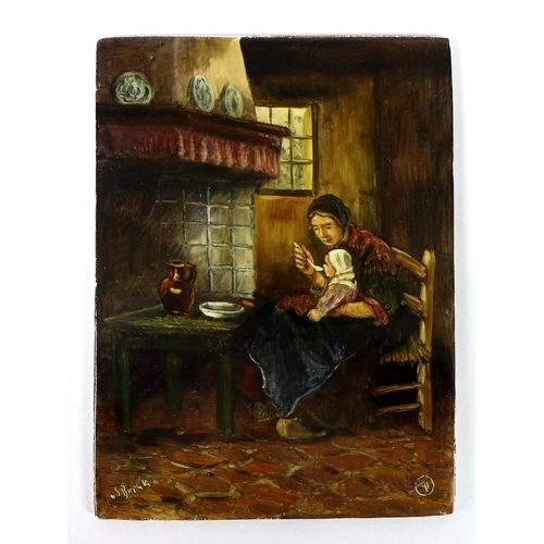 35 - An Edwardian hand painted tile, depicting an interior scene of 19th century Dutch mother feeding her...