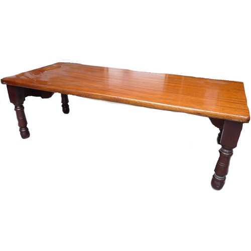 114 - An Edwardian mahogany bed table, with turned folding legs, 76 by 32 by 23.5cm high....
