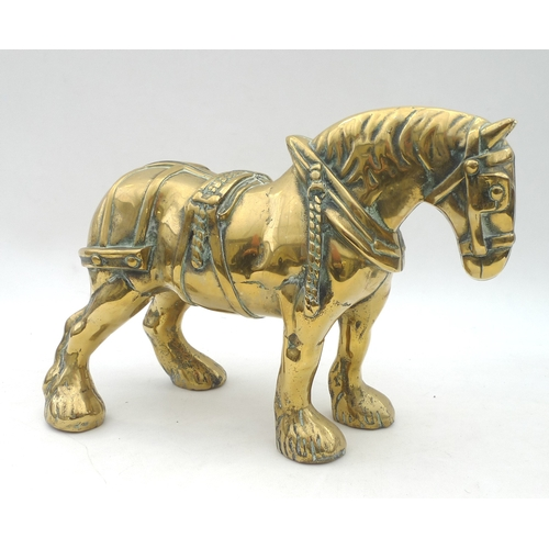 7 - A heavy cast brass shire horse figurine,  34 by 14 by 25.5cm high....