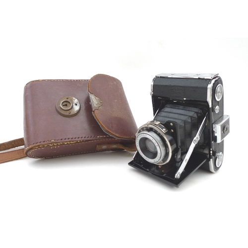 9 - A vintage Zeiss Ikon bellows camera, with vintage leather case....