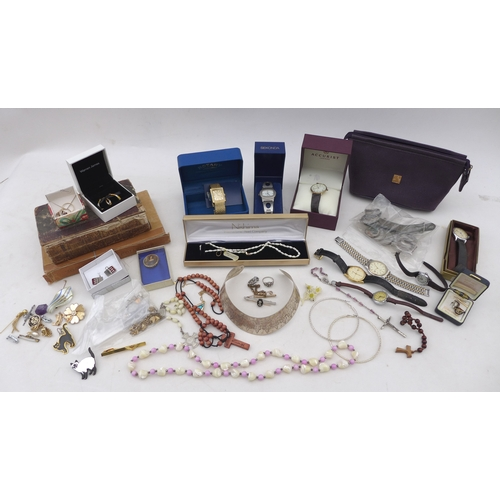 11 - A quantity of costume jewellery and quartz wristwatches, together with two books, a/f. (1 bag)...
