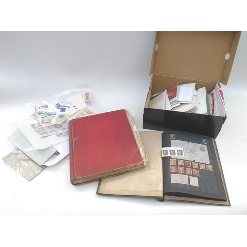 21 - Two albums of British and international stamps, including a used Penny Black some used Penny Reds, A...