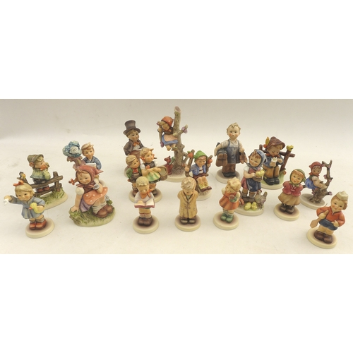23 - A group of seventeen Hummel figures, including 'Out of Danger' 8 by 16cm high. (17)...