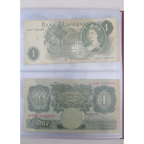 24 - A mixed collection of British and international coinage, including two albums, including some half s...