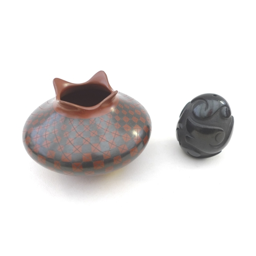 26 - Two pieces late 20th century Native American pottery, a Yoly Ledezma Native Pottery Vase with checqu...