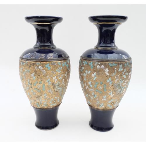 32 - A pair of Royal Doulton vases (2)...