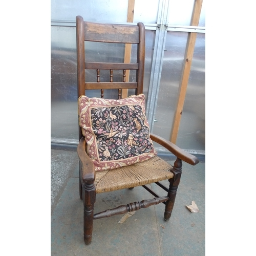 38 - A 19th century low oak ladderback chair, with rush seat, together with two brass jam pans. (3)...