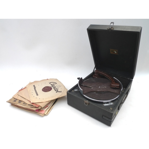 44 - An HMV portable record player with some vinyl 78s records. (Record player and 1 bag)....