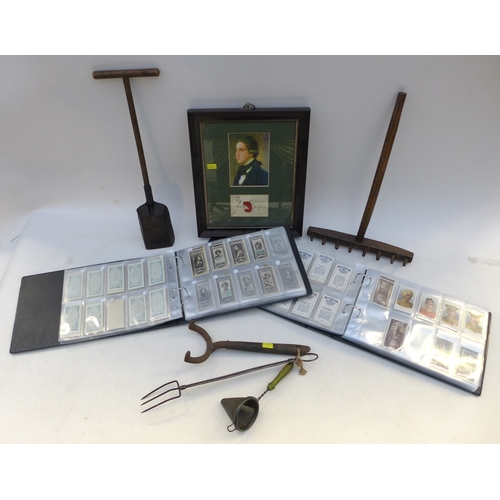 80 - A group of collectables including two albums of vintage cigarette cards, including military themed c...