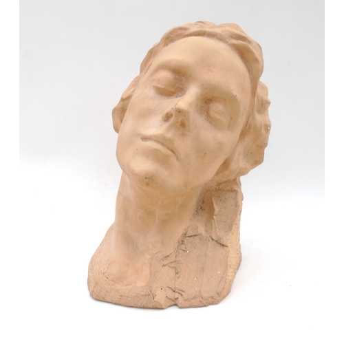3 - A plaster bust, modelled as a young lady, 32cm high....