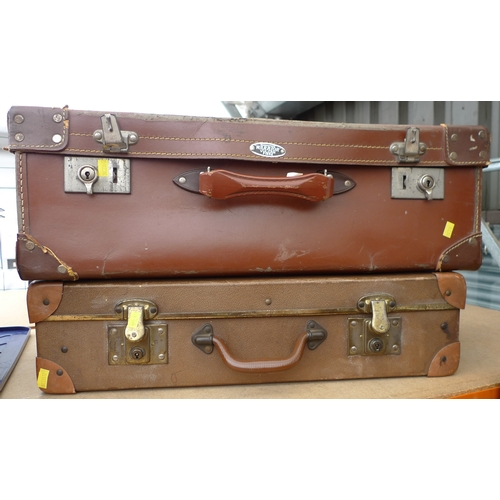 39 - A group of two vintage suitcases, comprising a brown leather case and a slightly smaller case with l...