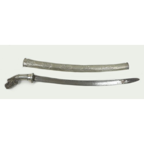 137 - A 19th century white metal and horn handled sword, likely an Indonesian parang or pedang, with silve...