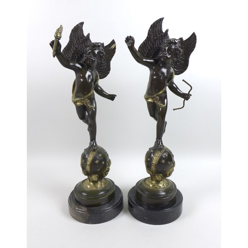 43 - Two modern bronze sculptures of winged putti, cast in the Baroque style, one holding a flaming torch...