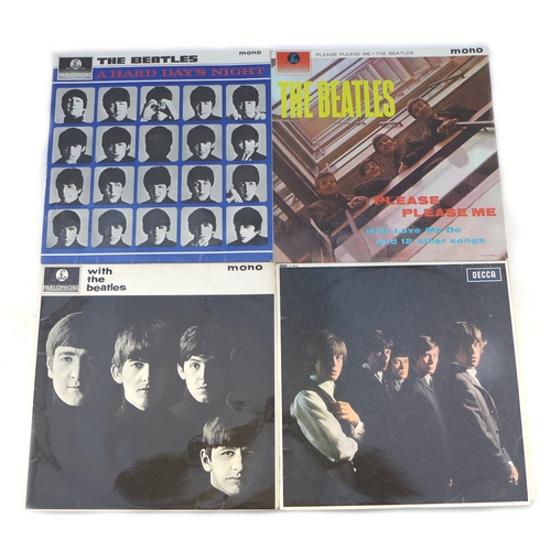 44 - An early pressing of the Rolling Stones first album vinyl, 'XARL 6271' together with three Beatles v...