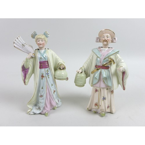17 - A pair of early 20th century Continental 'Nid Nod' ceramic figurines, modelled as a lady and gentlem...