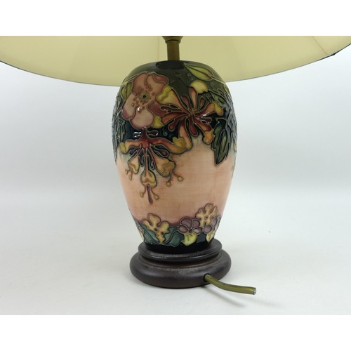 22 - A Moorcroft Pottery Oberon pattern table lamp, of ovoid form with circular wooden base and complimen...