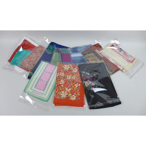46 - A collection of thirteen silk scarves, including some designer, comprising two Liberty scarves, blac...