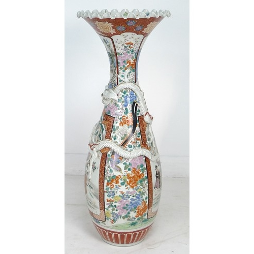 5 - A large 20th century Japanese floor standing vase, with a lobed rim and an applied dragon sprawling ...