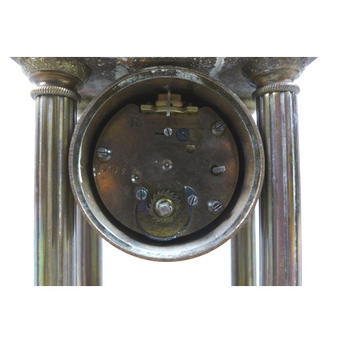 34 - A Victorian brass mantel clock, of architectural form, the white enamel 1.75