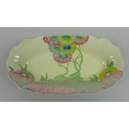 23 - Clarice Cliff for A. J. Wilkinson Ltd and Newport Pottery, a group of four floral pattern pieces, al...