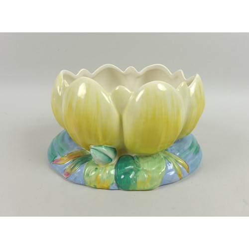 25 - A Clarice Cliff for Newport Pottery planter, circa 1940, formed as a water lily, painted in yellows,...