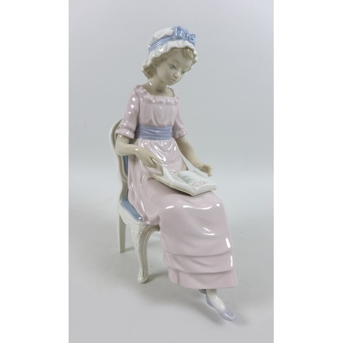 19 - Two Lladro figurines, modelled as a seated young lady reading 'My Poems', 5084, 8 by 16 by 23.5cm hi...
