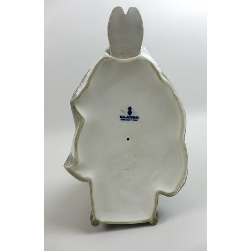 20 - A Lladro figurine, modelled as 'Insular Embroideress', 4865, 13 by 21 by 28cm high....