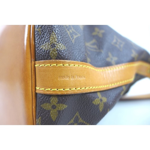 48 - A Louis Vuitton monogrammed Noe leather shoulder bag, with Louis Vuitton stamped brass eyelets, 38 b...