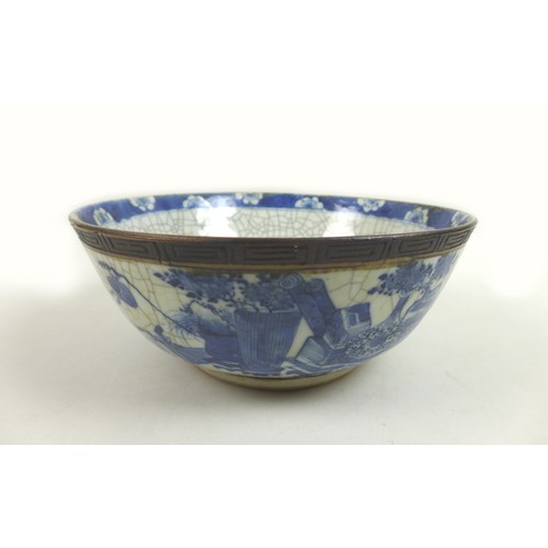 8 - A Chinese Qing Dynasty, late 19th century, porcelain bowl, decorated in underglaze blue and with cra...